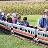 JULIE CROTHERS BEER | THE GOSHEN NEWS<br /> Children take a ride in a small train during the Antique Tractor and Engine Show Saturday during the Nappanee Apple Festival.