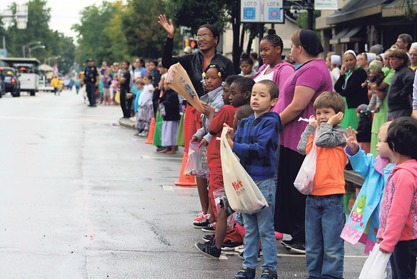 JULIE CROTHERS BEER | THE GOSHEN NEWS<br /> A group of children and adults gather in downtown Nappanee for the annual Nappanee Apple Festival parade.