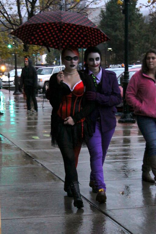 ". Bridget Tangway and Jessie Rosentuig, of North Adams, walk down Main Street on Halloween evening during the DownStreet Art \""Fright Night\"" on Thursday, Oct. 31, 2013 (Holly Pelczynski/Berkshire Eagle Staff)"
