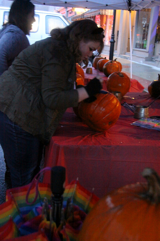 . Emily Boughton, a student of MCLA,  carves a pumpkin during DownStreet Art\'s Fright Night on Thursday, Oct. 31, 2013. (Holly Pelczynski/Berkshire Eagle Staff)