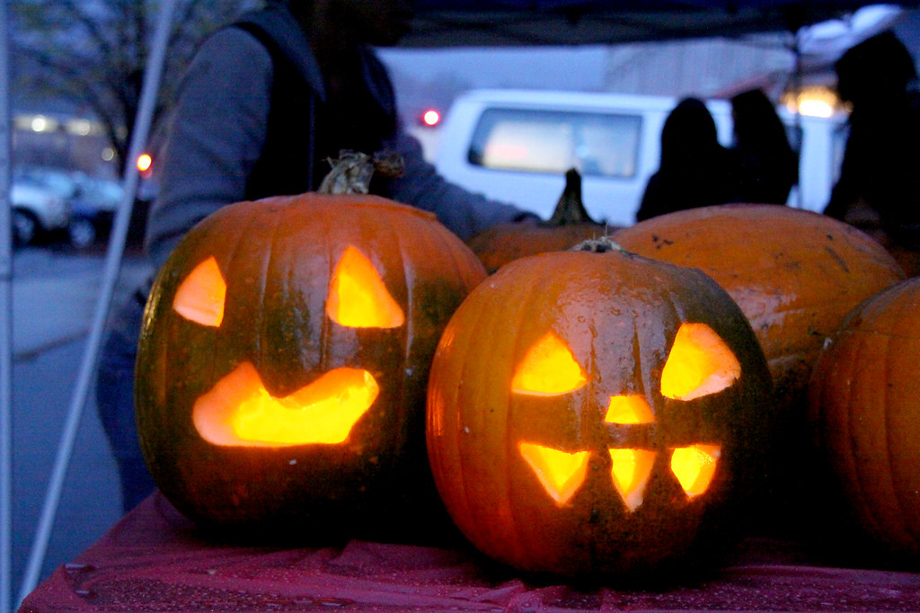 """. Jack-o-lanterns sit wet from the rain on Thursday, Oct. 31, 2013. The pumpkins were carved as part of \""""The Great Pumpkin Carve,\"""" part of DownStreet Art \'Fright Night\'. (Holly Pelczynski/Berkshire Eagle Staff)"""