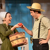 HALEY WARD | THE GOSHEN NEWS<br /> Abby Murray Vachon, as Hilda, takes a tomato from Will Herndon, as Ezra, during rehersals for Plain and Fancy on Tuesday at the Round Barn Theatre.