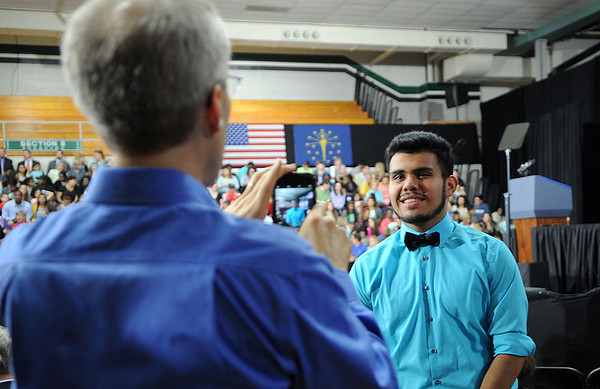 HALEY WARD | THE GOSHEN NEWS<br /> Brian Wiebe, Executive Director of Horizon Education Alliance, takes a picture of Elkhart Memorial junior Juan Vaca Ramirez in front of the stage before President Barack Obama's speech on Wednesday at Concord High School. The two met Obama on his visit.