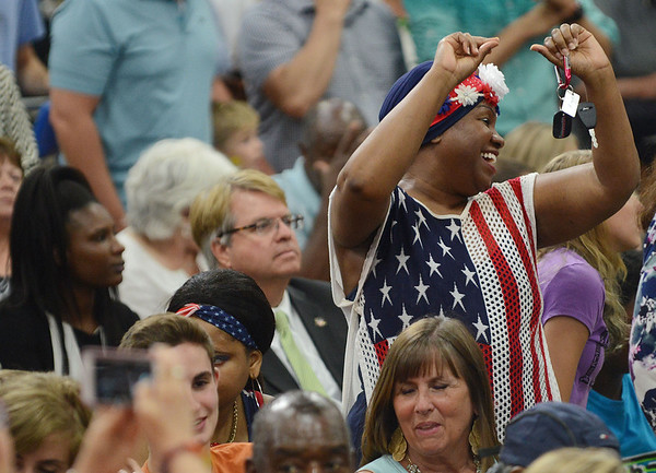 HALEY WARD | THE GOSHEN NEWS<br /> A woman dances while waiting for President Barack Obama to come out on stage to speak Wednesday at Concord High School.