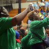 HALEY WARD | THE GOSHEN NEWS<br /> People take photos of the stage before President Barack Obama's speech on Wednesday at Concord High School.