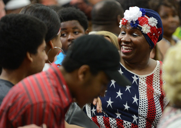 HALEY WARD | THE GOSHEN NEWS<br /> A woman in the crowd smiles before  President Barack Obama's visit to Concord High School on Wednesday.