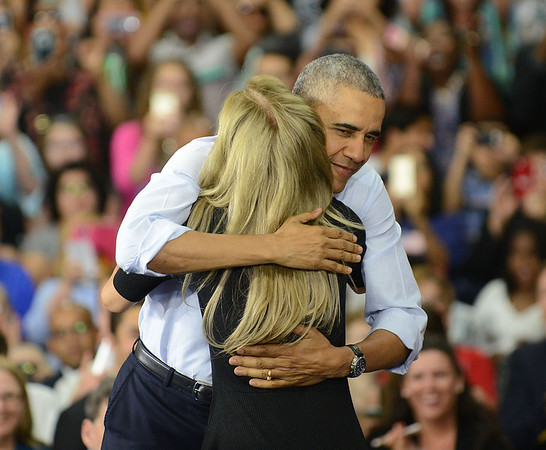 HALEY WARD | THE GOSHEN NEWS<br /> President Barack Obama hugs Kelly Rizzo after her introduction at Concord High School on Wednesday.
