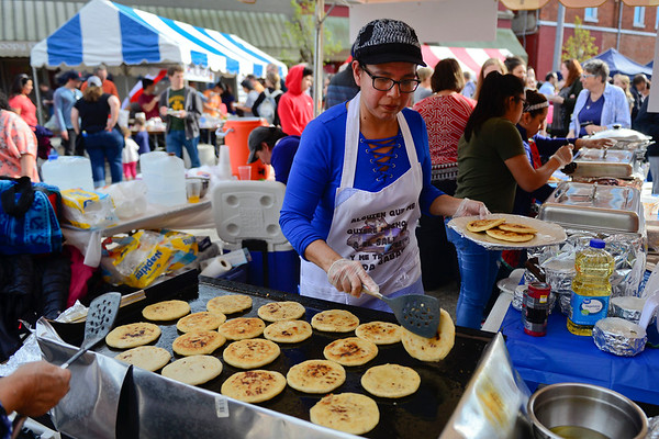 BEN MIKESELL | THE GOSHEN NEWS<br /> Blanca Dilworth, Goshen, flips pupusas, a popular Salvadoran dish, Friday during First Friday's Taste of Goshen on East Washington Street.