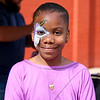 "LEANDRA BEABOUT | THE GOSHEN NEWS<br /> Nyana Holiday, 10, had her face painted at Goshen's ""Taste of the Festival"" First Friday event."