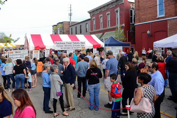 BEN MIKESELL | THE GOSHEN NEWS<br /> People line up to eat at Taste of Goshen during May's First Friday event on East Washington Street.