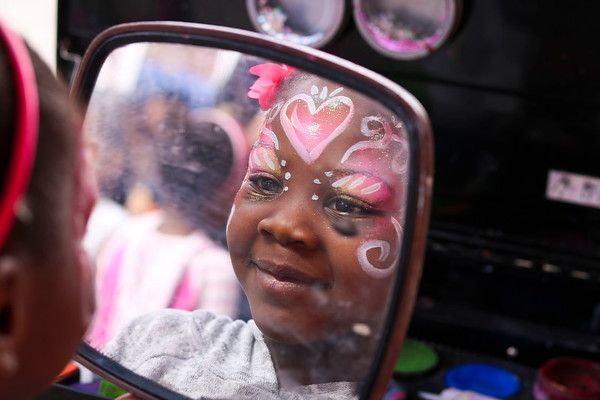 "LEANDRA BEABOUT | THE GOSHEN NEWS<br /> Journii Holiday, 6, got her face painted at Goshen's ""Taste of the Festival"" First Friday event."