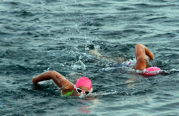 SHERRY VAN ARSDALL | THE GOSHEN NEWS<br /> Particpants swam in a 500-yard swim during the first portion of the Rock the Quarry Triathlon at Fidler Pond in Goshen Saturday.