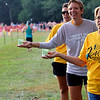 SHERRY VAN ARSDALL | THE GOSHEN NEWS<br /> From right, Donna Patuzzi, Twyla Kendrick and Jen Bowman manned the water station and cheered for the participants at the first transition area during the Rock the Quarry Triathlon at Fidler Pond in Goshen Saturday.
