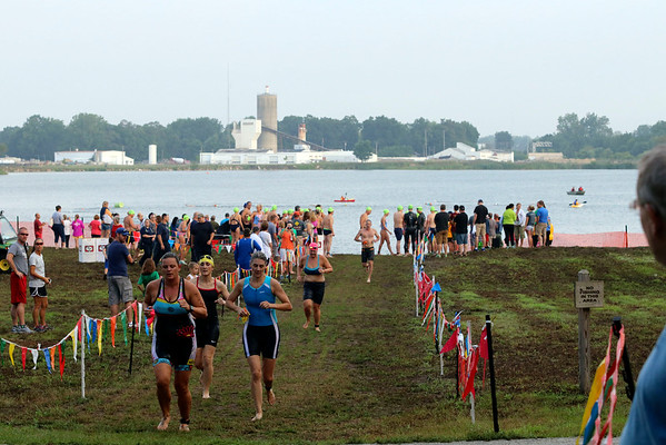 SHERRY VAN ARSDALL | THE GOSHEN NEWS<br /> Particpants completed a 500-yard swim during the first portion of the Rock the Quarry Triathlon at Fidler Pond in Goshen Saturday.