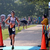 SHERRY VAN ARSDALL | THE GOSHEN NEWS<br /> A particpant makes his way around the perimeter of the pond during the final portion of the Rock the Quarry Triathlon at Fidler Pond in Goshen Saturday.