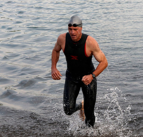 SHERRY VAN ARSDALL | THE GOSHEN NEWS<br /> A particpant completed a 500-yard swim during the first portion of the Rock the Quarry Triathlon at Fidler Pond in Goshen Saturday.