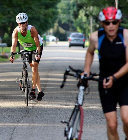 SHERRY VAN ARSDALL | THE GOSHEN NEWS<br /> Particpants completed a 15.8 mile bike ride during the second portion of the Rock the Quarry Triathlon at Fidler Pond in Goshen Saturday.