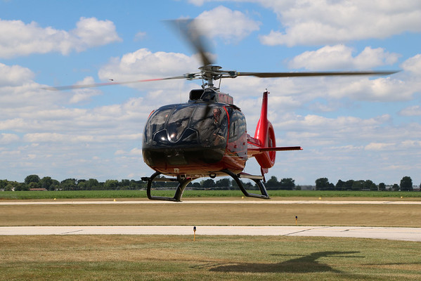GEOFF LESAR | THE GOSHEN NEWS<br /> <br /> Pilot Chuck Surack, Fort Wayne, lands an Airbus H130 Saturday on the Goshen airport runway at the fifth annual Rotors 'n Ribs