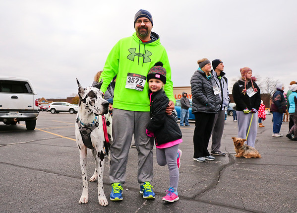 LEANDRA BEABOUT | THE GOSHEN NEWS<br /> Shelby the Great Dane, Jason Schumaker and Lani Schumaker, 5, all of Mishawaka