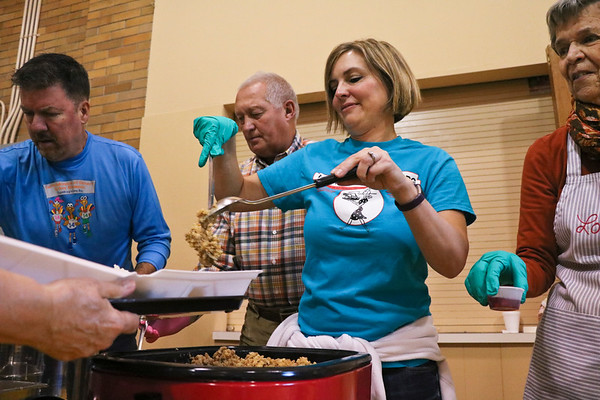 LEANDRA BEABOUT | THE GOSHEN NEWS<br /> Scott Salisbury of Goshen, Bruce Klonowski of Middlebury, Jessica Elliott of Middlebury and Loretta Reynolds of Goshen helped service Thanksgiving dinner at Goshen's First United Methodist Church.