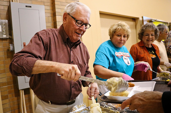 LEANDRA BEABOUT | THE GOSHEN NEWS<br /> Dick Vandenoever of Goshen helps serve Thanksgiving dinner at his church.