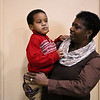 LEANDRA BEABOUT | THE GOSHEN NEWS<br /> Noh'lan Suggs, 3, is held by his mother Clarice Henry as he takes a break from Thanksgiving dinner at First United Methodist Church.