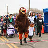 "LEANDRA BEABOUT | THE GOSHEN NEWS<br /> The final course of the Turkey Stampede was a one-mile walk, led by Cody Mishler as ""Gobbles"" and Holly Mishler as a pilgrim."