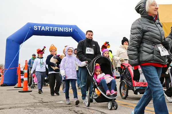 "LEANDRA BEABOUT | THE GOSHEN NEWS<br /> Race organizer Paula Turk said that the Turkey Stampede is a great ""multi-generational"" family event, with courses that appeal to adults and kids alike."