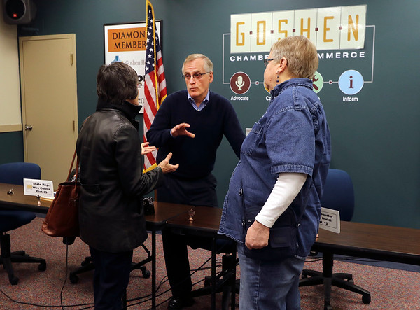 JULIE CROTHERS BEER | THE GOSHEN NEWS<br /> Rep. Wes Culver, R-Goshen, speaks with Goshen City Council representative Julia Gaustche, left, and Goshen resident Connie Garber, right, after a Third House meeting Saturday, March 4 at the Goshen Chamber of Commerce.