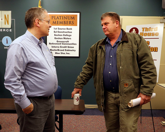 JULIE CROTHERS BEER | THE GOSHEN NEWS<br /> Dr. Dan Nafziger, health officer for Elkhart County, speaks with state Sen. Blake Doriot, R-Syracuse, after a Third House meeting Saturday, March 4 at the Goshen Chamber of Commerce.