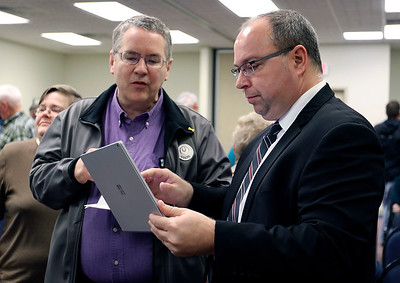JULIE CROTHERS BEER | THE GOSHEN NEWS Dr. Dan Nafziger, health officer for Elkhart County, speaks with State Rep. Curt Nisly, R-Goshen, about the dangers of Lyme disease after a Third House meeting Saturday, Jan. 21 at the Goshen Chamber of Commerce.