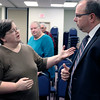 JULIE CROTHERS BEER | THE GOSHEN NEWS<br /> Erin Yoder, Goshen, speaks with State Rep. Curt Nisly, R-Goshen, about his proposed abortion bill after a Third House meeting Saturday, Jan. 21 at the Goshen Chamber of Commerce.