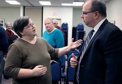 JULIE CROTHERS BEER | THE GOSHEN NEWS Erin Yoder, Goshen, speaks with State Rep. Curt Nisly, R-Goshen, about his proposed abortion bill after a Third House meeting Saturday, Jan. 21 at the Goshen Chamber of Commerce.