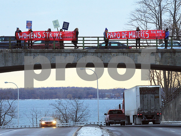 """Spencer Tulis/Finger Lakes Times A group of women hold banners Monday morning at the S. Main Street bridge that is an overpass for Route 5 & 20. They were there to promote,, according to a flyer,  a """"Geneva Women's Assembly"""" to take place at noon at 433 Exchange St. in Geneva in front of Representative Tom Reed's office. Promoters, who include some involved in """"Resist Trump Tuesdays,"""" say the gathering will be similar to ones that will span many countries around the world that day. The group also says """"In solidarity with striking women all over the world, we will celebrate and build on the vibrant, ongoing, and often invisible work of Geneva's women, small towns and communities, and the Finger Lakes. Strike, walk out, sick out, take a long lunch, take a break from stress and isolation, bring the kids and join with others to share your experience, goals, and ideas for the society we should be. The Geneva Women's Assembly will welcome everyone, all genders and ages, including children. Organizers say a strike fund can cover missed wages that make it hard to take off work."""""""