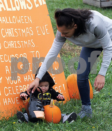 Spencer Tulis/Finger Lakes Times Railyn Rogers of Seneca Falls positions her son Adryan, 1, just right in preparation of a photo to be taken Sunday at the Meadeville Farm Pumpkin Patch on Route 5 & 20 east of downtown Seneca Falls.