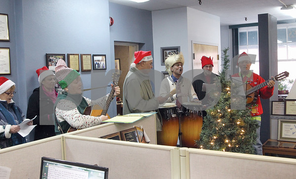 """Spencer Tulis/Finger Lakes Times The """"Puerto Rican Christmas Carolers"""" made their way around the city of Geneva this week, including at the Finger Lakes Times, to show to spread the Christmas cheer through song."""