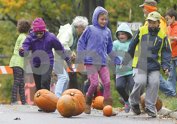 Spencer Tulis/Finger Lakes Times The 6th annual Hildreth Hill Pumpkin Roll was recently held with other fun activities provided for children. A portion of Brook Street was closed for the ocassion that included a bake sale, music, face painting and more.