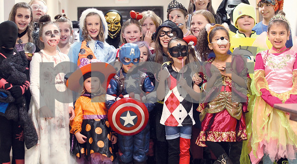 Spencer Tulis/Finger Lakes Times Kids of all ages, in a avriety of costumes from St. Francis-St. Stephen School in Geneva enjoyed a Halloween-filled evening and party Friday at the Parish Center adjacent to the St. Francis Church.