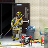"A firefighter exits the building after investigating an alleged roof collapse on Wednesday, Aug. 1, at Erie Middle School in Erie. For more photos and video of the accident go to  <a href=""http://www.dailycamera.com"">http://www.dailycamera.com</a><br /> Jeremy Papasso/ Camera"