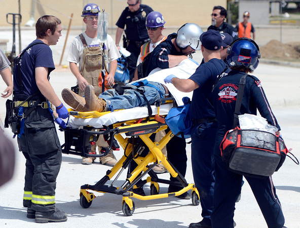 "Rescue workers transport a victim to the medical helicopter to be transported to the hospital on Wednesday, Aug. 1, after the roof allegedly collapsed at Erie Middle School in Erie. For more photos and video of the accident go to  <a href=""http://www.dailycamera.com"">http://www.dailycamera.com</a><br /> Jeremy Papasso/ Camera"