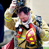 "A firefighter exits the building on Wednesday, Aug. 1, at Erie Middle School in Erie after rescuing people trapped from a roof that allegedly collapsed. For more photos and video of the accident go to  <a href=""http://www.dailycamera.com"">http://www.dailycamera.com</a><br /> Jeremy Papasso/ Camera"