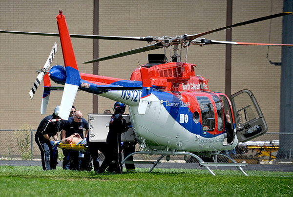 Rescue workers load an injured passenger into a helicopter outside the Erie middle school building after an explosion Wednesday afternoon. August 1, 2012. Rachel Woolf/ For the Daily Camera