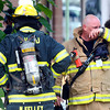 "A firefighter wipes sweat from his face after rescuing people that were allegedly trapped inside from a roof that collapsed on Wednesday, Aug. 1, at Erie Middle School in Erie. For more photos and video of the accident go to  <a href=""http://www.dailycamera.com"">http://www.dailycamera.com</a><br /> Jeremy Papasso/ Camera"