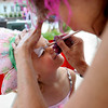 "Lena Oliver, 3 of Niwot, who prefers to be called ""baby cheetah"", gets her face painted as a cheetah by Susan Meylor of Sparkles Face Painting at the first annual festival of faerie in Lafayette Saturday afternoon. The festival featured music, entertainment and various faerie themed activities.<br />  <a href=""http://www.dailycamera.com"">http://www.dailycamera.com</a><br /> Rachel Woolf/ For the Camera<br /> For More Photos, go to  <a href=""http://www.dailycamera.com"">http://www.dailycamera.com</a>"