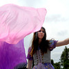 "Sam Lee, of Boulder, who is acting as Clio the Dust Fairy, waves fan veils around in circles at the first annual festival of faerie in Lafayette Saturday afternoon. The festival featured music, entertainment and various faerie themed activities.<br />  <a href=""http://www.dailycamera.com"">http://www.dailycamera.com</a><br /> Rachel Woolf/ For the Camera<br /> For More Photos, go to  <a href=""http://www.dailycamera.com"">http://www.dailycamera.com</a>"