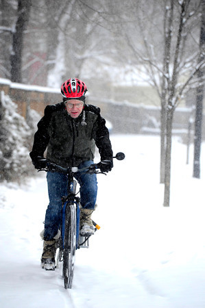 COBOU102.JPG David Wilson rides to work in Boulder Colo. on a snowy Thursday morning. He says he bikes to work no matter what the weather.<br /> Thiursday February 21, 2013<br /> Photo by Paul Aiken / The Daily Camera /