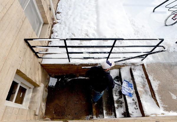 """George Wallack of CU's Facilities Management, removes snow from the geology Building at CU.<br /> For a video and photo gallery of the snow, go to  <a href=""""http://www.dailycamera.com"""">http://www.dailycamera.com</a>.<br />  Cliff Grassmick  / February 21, 2013"""