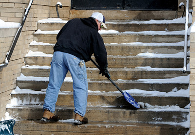 George Wallack of CU's Facilities Management, removes snow from the geology Building at CU. For a video and photo gallery of the snow, go to www.dailycamera.com.  Cliff Grassmick  / February 21, 2013