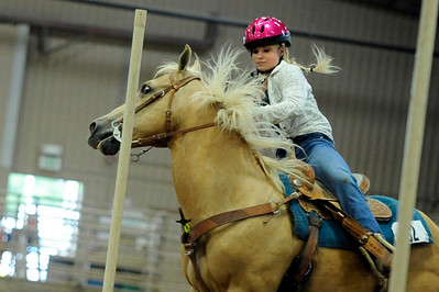 "Jessica Hanson, 17, of Longmont, tries to take control of her horse ""Leo's Echo Bar"" during the Senior Keyhole event at the Indoor Arena at the Boulder County Fairground in Longmont on Thursday, July 29. Jeremy Papasso/ Camera"