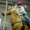 "Jessica Hanson, 17, of Longmont, tries to take control of her horse ""Leo's Echo Bar"" during the Senior Keyhole event at the Indoor Arena at the Boulder County Fairground in Longmont on Thursday, July 29.<br /> Jeremy Papasso/ Camera"